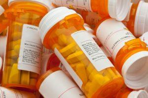 Several Prescription Pill Bottles in a Pile